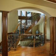 articulated-curved-staircase-cherry-wood-iron-railing