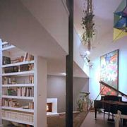 diagonal-bridge-2-story-bookcase-creates-interior-drama